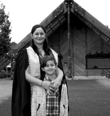 Tineka Bartlett and her son in front of marae